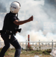 Turkish riot police attack trade unionists with tear gas during the Gezi Park protests.