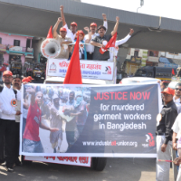 Workers in India show solidarity with their comrades in Bangladesh on a May Day march.
