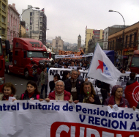 Supporters of striking Chilean dockers parade through the streets.